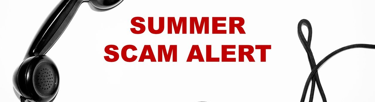 Black telephone with summer scam alert text written beside it